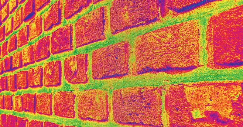 Coefficient de transmission thermique moyen d'un mur contre terre