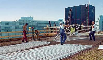 Photo chantier mise en place dalle active, module préfabriqué.